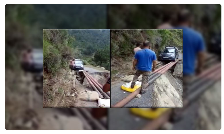 Panic alert! Car crosses broken road on makeshift pole-bridge Himachal Pradesh. Watch