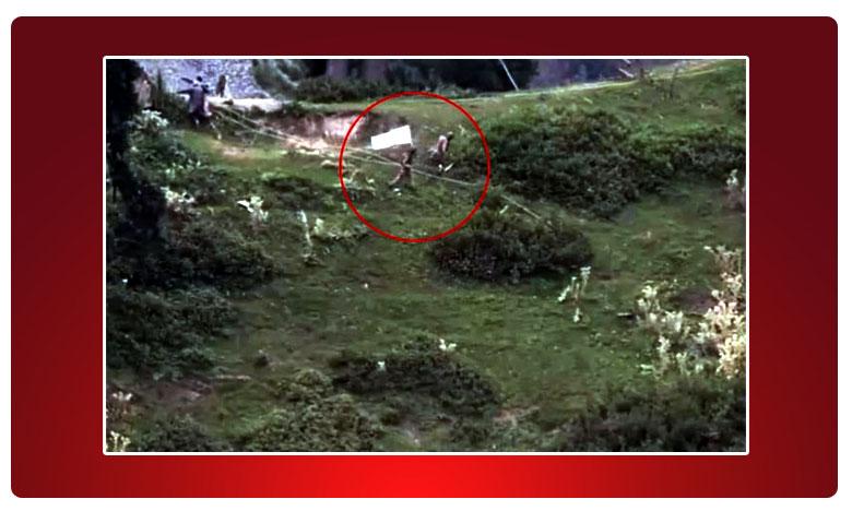 Pak Soldiers With White Flag Retrieve Bodies Near LoC