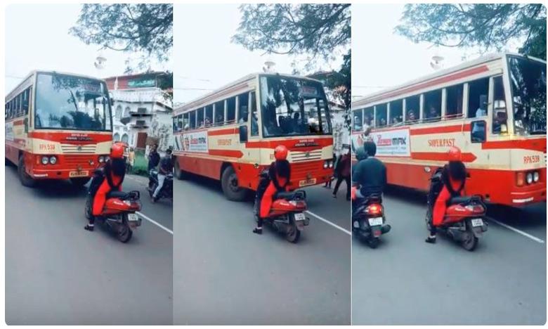 badass kerala woman on scooty makes bus driver take right lane internet explodes in praise, రాంగ్ రూట్ డ్రైవర్కు స్ట్రాంగ్ వార్నింగ్ ఇచ్చిన లేడీ