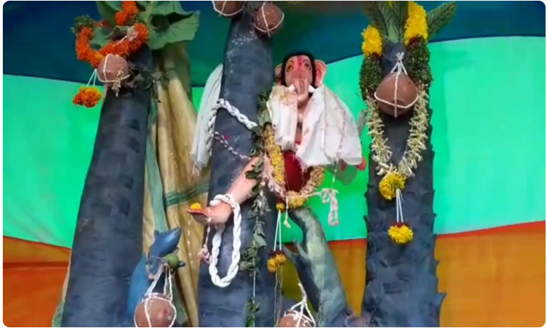 toddy workers new idea ganesh statue at the top of the tree in yadadri