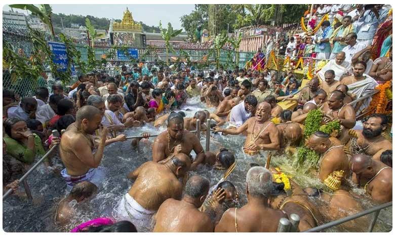 Tirumala Brahmotsavam: Chakrasnanam for Srivaru, తిరుమల బ్రహ్మోత్సవాలు: అత్యంత వైభవంగా శ్రీవారి చక్రస్నానం