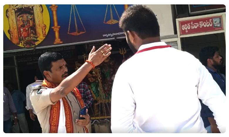 CI creates ruckus in Vijayawada temple, సేవ చేయడానికొస్తే సీఐతో తిట్లు..