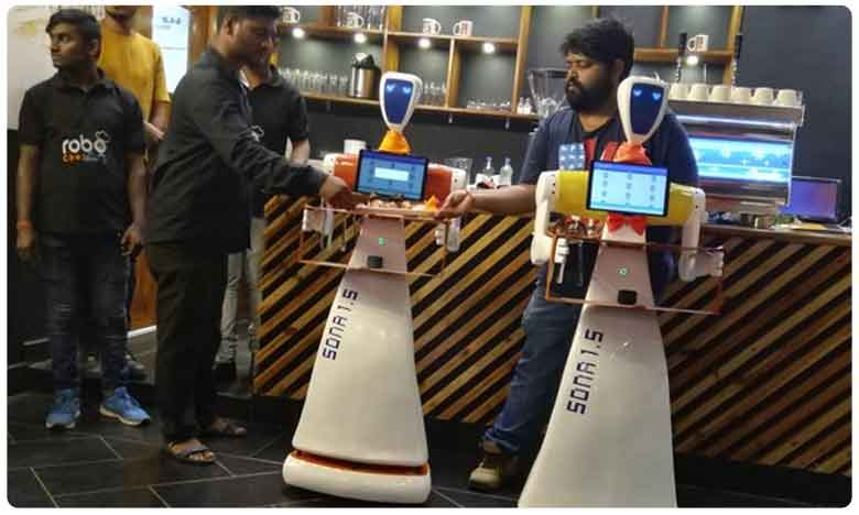 Two Humanoid Robots Serve Customers in Restaurant In Odisha, వీడియో: భోజనం సర్వ్ చేస్తున్న రోబోలు.. ఎక్కడో తెలుసా..?