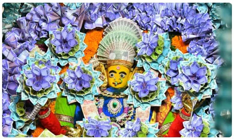 Goddess Kanyakaparameswari decorated with currency notes worth rupees 3 crores, నిజంగా ధనలక్ష్మే… రూ.3 కోట్లతో కన్యకాపరమేశ్వరికి అలంకారం!