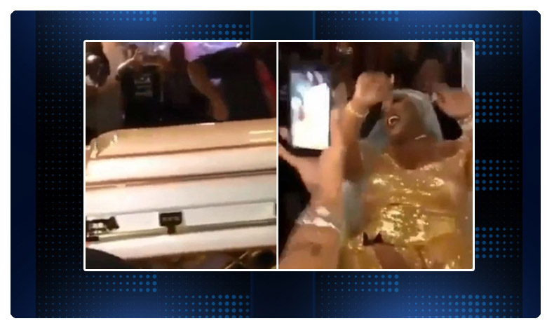 """The video shows the bride dancing and laughing as soon as the coffin is opened, శవ పెటికలో """"పెళ్లి కూతురు'..! అవాక్కైన అతిథులు..!"""