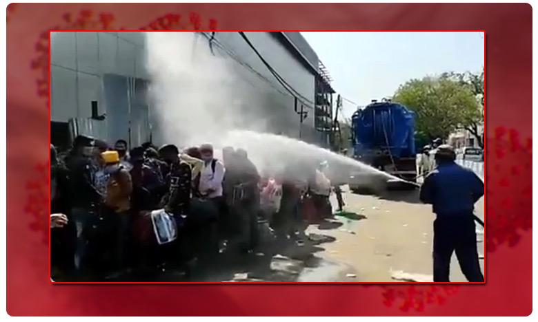 Migrant Workers, వలస కూలీలపై క్లోరినేషన్ ! పొరబాటైపోయిందట !